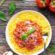Pomodoro sauce recipe on a bed of gluten-free spaghetti in a white bowl.