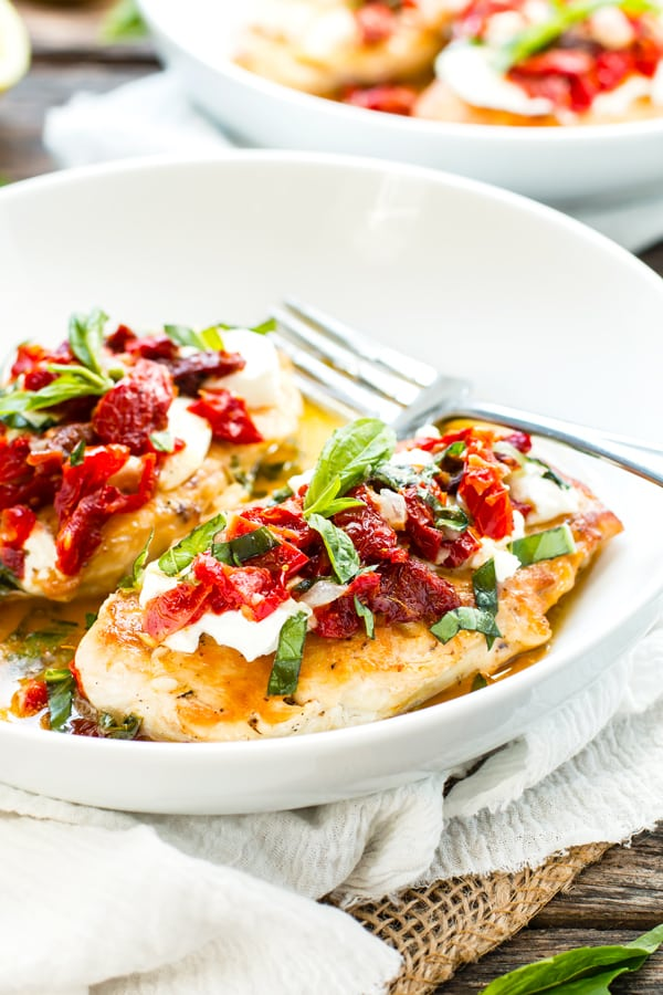 Sundried Tomato & Goat Cheese Chicken is a recreation of Carrabba's Chicken Bryan.  Easy skillet chicken is topped with fresh goat cheese, sundried tomatoes, basil and the most delicious lemon sauce for a low-carb and gluten-free dinner recipe.