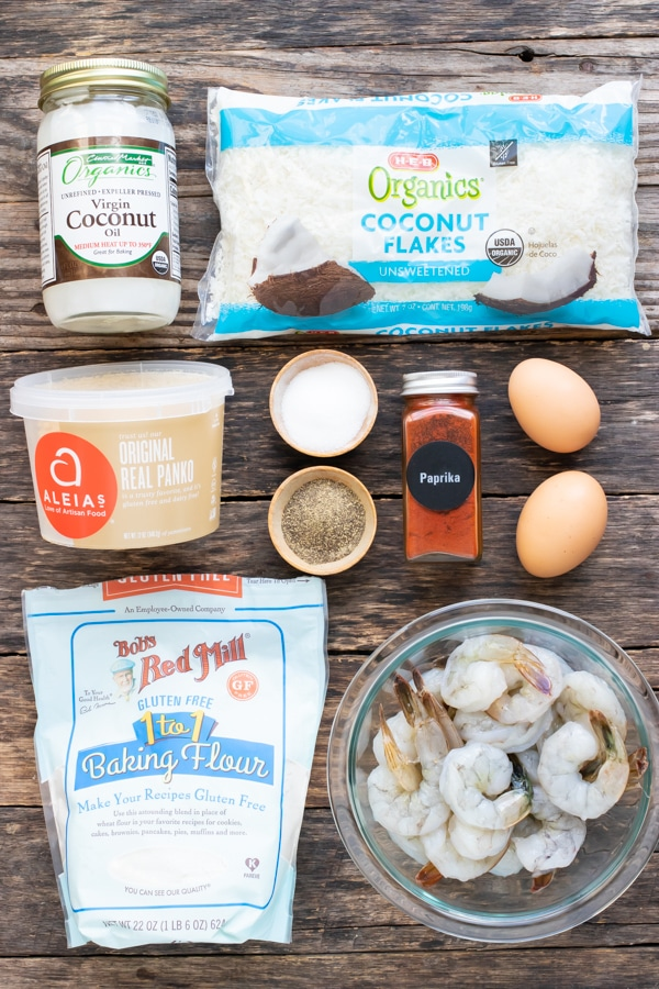 Unsweetened shredded coconut, coconut oil, Panko bread crumbs, egg, flour, and shrimp as ingredients for a coconut shrimp recipe.
