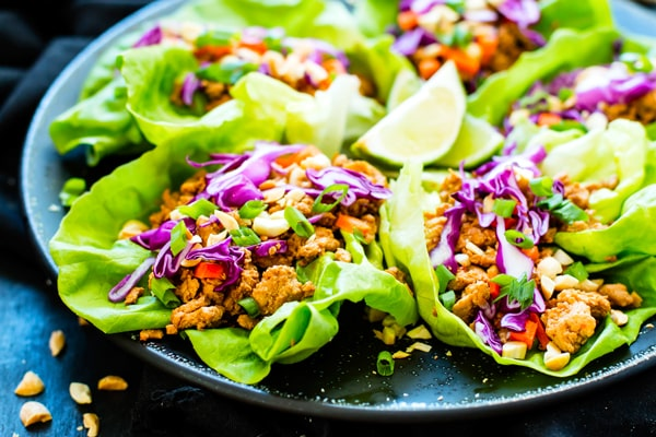 Low-carb Thai chicken wraps on a plate for a light lunch.