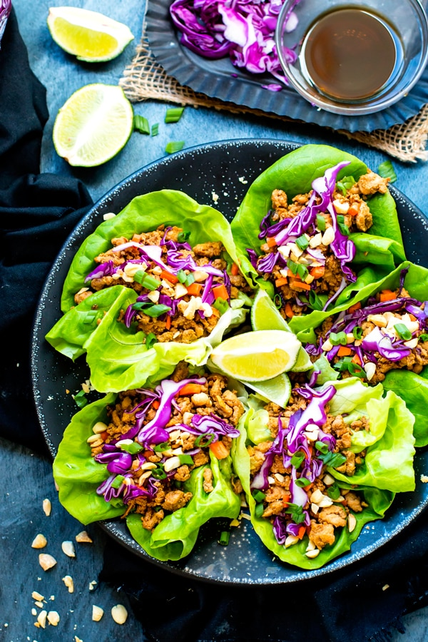 An overhead picture of gluten-free Thai chicken lettuce wraps with lime.