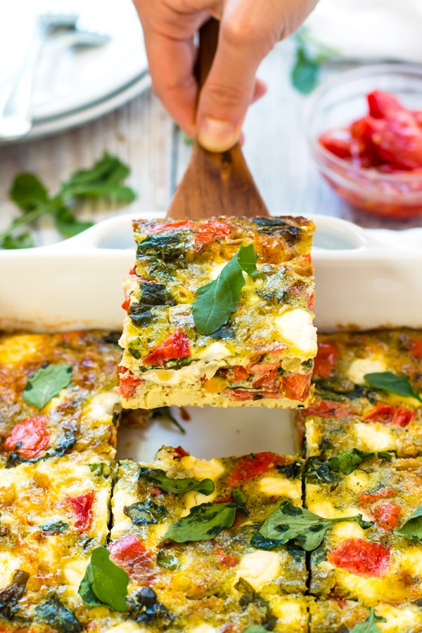 Baked Frittata with Pesto, Tomatoes & Goat Cheese | An easy breakfast bake full of eggs, roasted tomatoes, pesto and goat cheese. It makes a healthy vegetarian and gluten-free breakfast recipe!