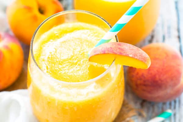 Frozen sangria recipe made with peaches for an easy summer drink.
