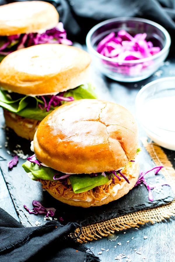 A row of gluten-free Slow Cooker Hawaiian Chicken Sandwiches ready for a healthy dinner.