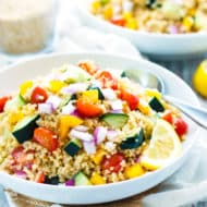 Gluten-free quinoa salad dressing with a summer vegetable quinoa salad for a healthy lunch.