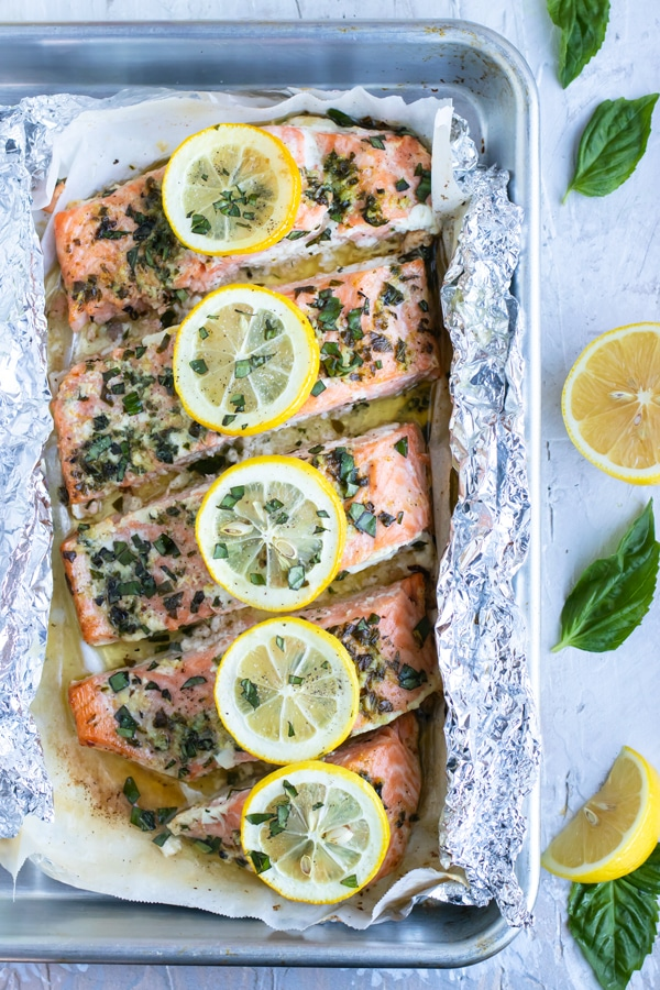 An easy foil packet seafood dinner recipe with fresh basil and lemon juice.