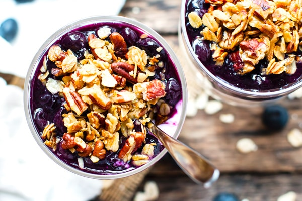 The top of an overnight oats recipe with blueberries and pecans.