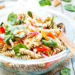 Italian Dressing Pasta Salad made with Parmesan Cheese in a serving bowl on a white napkin.