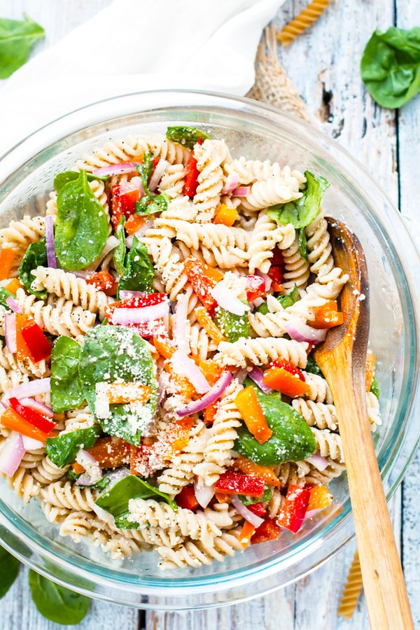 A healthy pasta salad recipe in a bowl on a table for dinner.