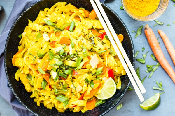 Golden Thai Curry Noodles are loaded with vegetables and protein and have become one of our go-to dishes at our favorite Thai restaurant.  With a few simple tweaks, this stir-fry dish can easily be made gluten-free, vegan, vegetarian, Paleo and low-carb!