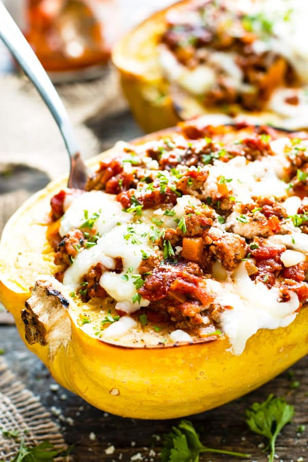 Lasagna Spaghetti Squash Boats with a fork on a table.