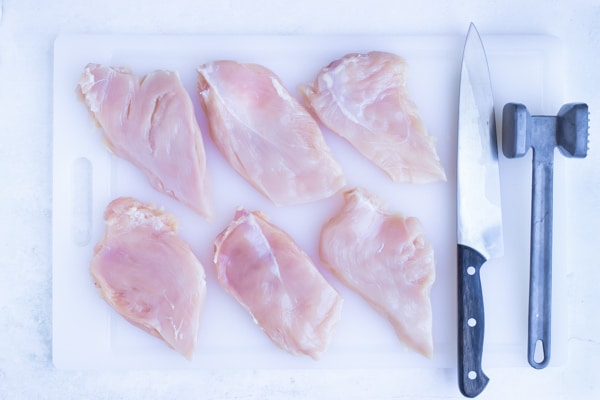 Prepare chicken by pounding into thin cutlets.