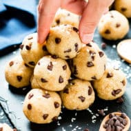 Appease your inner cookie monster with these healthy chocolate chip cookie dough bites. These no-bake, raw, energy bites are crazy simple to make and are vegan, gluten-free, dairy-free, vegetarian, and can easily be made Paleo! Healthy cookie dough energy bites make great kid-friendly snacks, too!