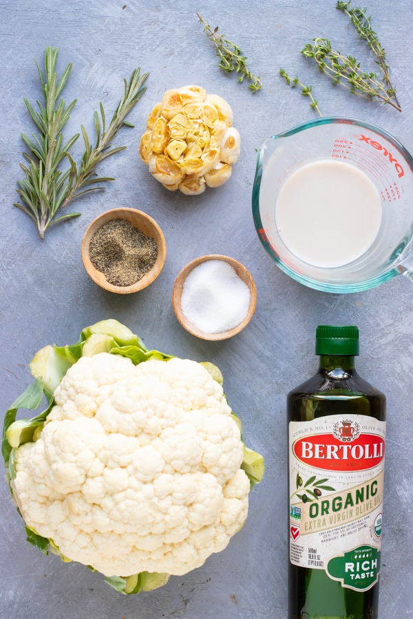 Cauliflower, garlic, oil, milk, and herbs as the ingredients for the best mashed cauliflower potatoes recipe.