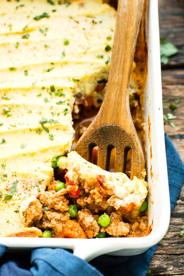 A close up picture of Ground Turkey Shepherd's Pie being served with a wooden spoon.