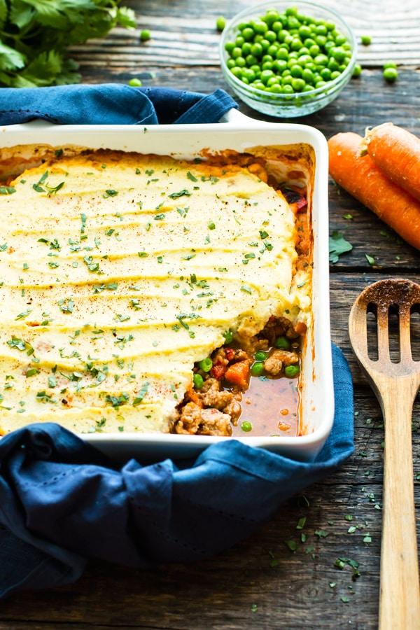 Ground Turkey Shepherd's Pie is made with a mashed cauliflower topping, ground turkey, and fresh herbs for a comforting low-carb dinner recipe.  It is Whole30 and Ketogenic diet approved and can easily be made Paleo!