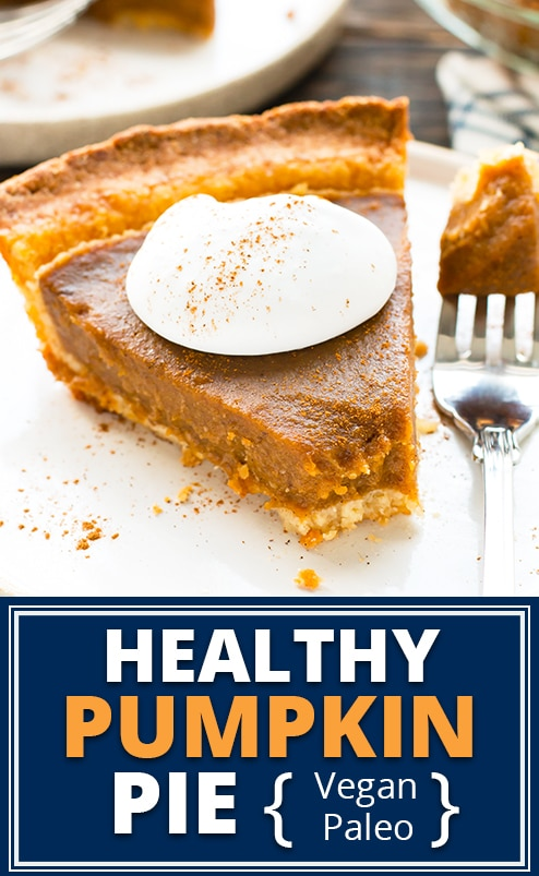 Healthy pumpkin pie with coconut whipped cream on a white plate.