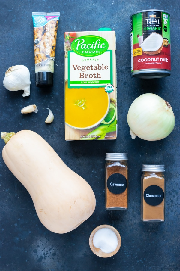Butternut squash, coconut milk, onion, ginger, garlic, vegetable broth, and spices as the ingredients for a roasted butternut squash soup recipe.
