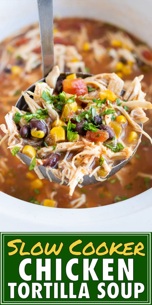 A big bowl of Crock-Pot chicken tortilla soup with corn, tomatoes, black beans, and cilantro on top.