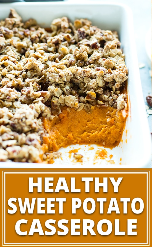 Healthy sweet potato casserole in a white baking pan with a pecan crumble.