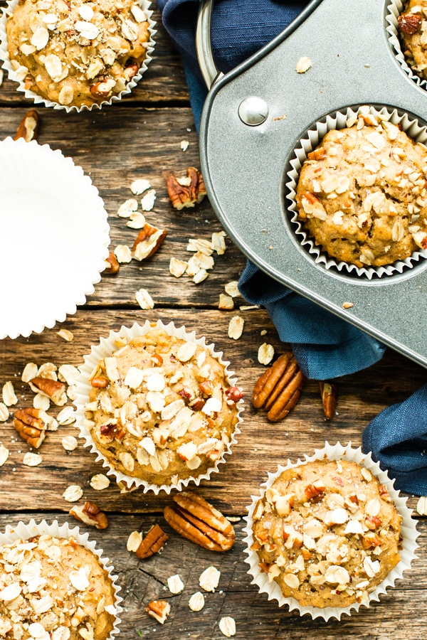 Gluten-free muffins recipe with maple and pecan on a wood table for a healthy breakfast.