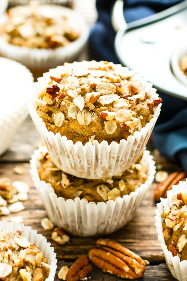 Vegan oatmeal muffins in a stack on a table for a healthy treat.