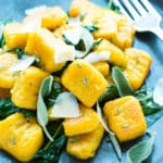 A close up picture of Butternut Squash Gnocchi on a blue plate as a healthy side.