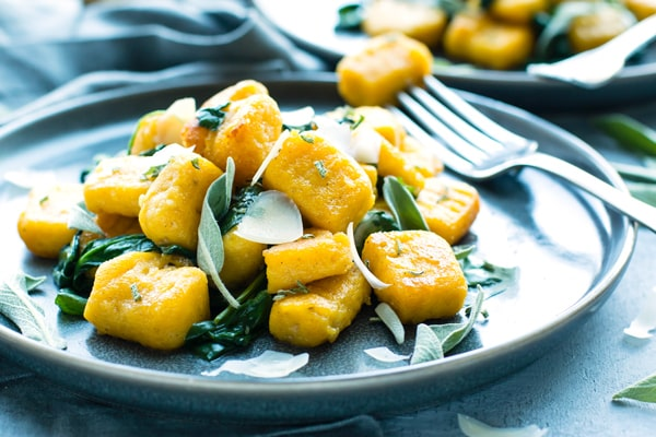 A serving of this gnocchi recipe made with butternut squash with a fork on the side.