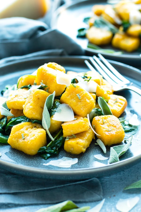 Gluten-free Butternut Squash Gnocchi with Lemon-Sage Sauce on a plate with a blue napkin.