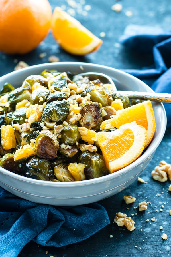 Orange and Maple Glazed Brussels Sprouts in a bowl for a healthy dinner.