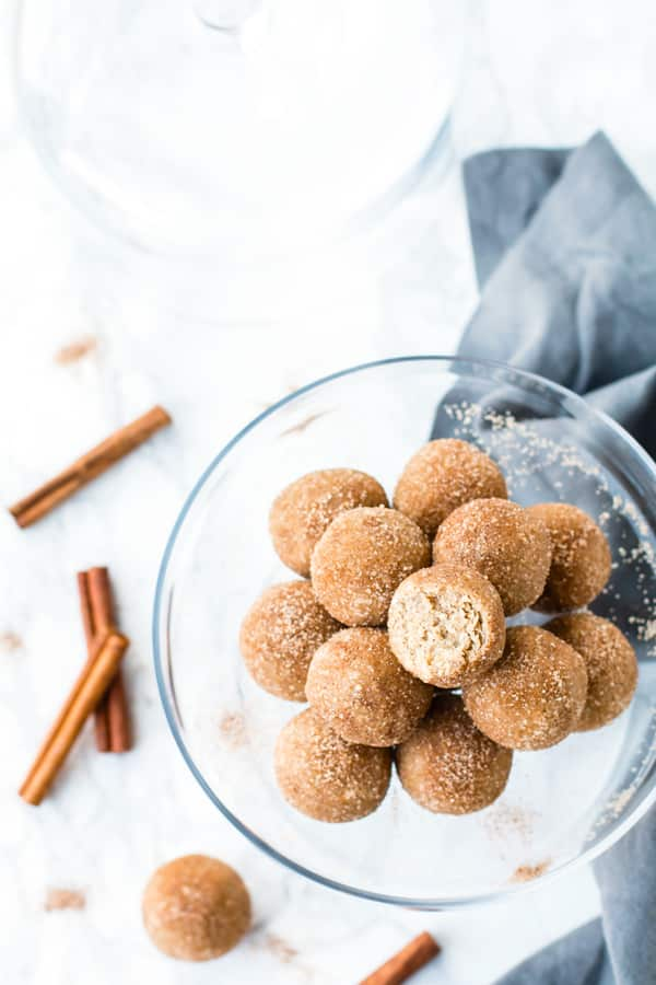 "Healthy Snickerdoodle Cookie Dough Bites | Enjoy your sweets while still loading up on nutrition with these gluten-free, dairy-free, and vegan Snickerdoodle Cookie Dough Bites.  This healthy ""cookie dough"" recipe only requires a few simple ingredients and no baking!"