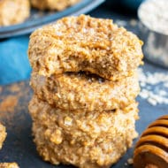A stack of almond butter oatmeal cookies with a bite taken out.
