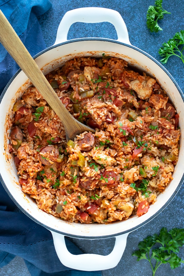 A Dutch oven full of a sausage Jambalaya recipe for a Cajun Mardi Gras party.