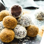 Gluten-free paleo fudge truffles in a pile on a gray table.