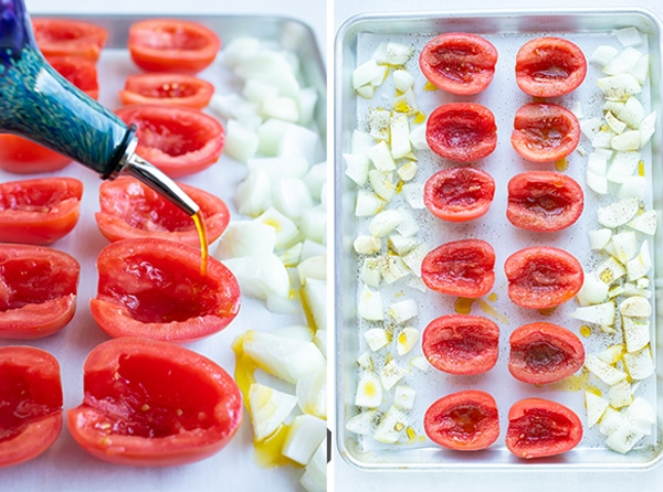 Pouring olive oil over tomatoes and onions to be roasted in the oven.