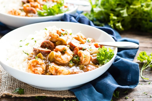 A bowl full of authentic shrimp gumbo with a spoon.