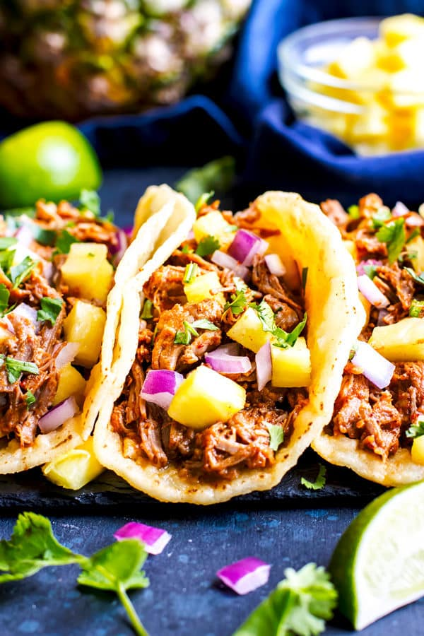 Instant Pot Tacos al Pastor are super tender, full of fresh pineapple and spicy chipotle, and are a simple Instant Pot pork recipe. Serve these Instant Pot tacos al Pastor | Al Pastor Tacos are made a quick and easy Instant pot dinner in gluten-free corn tortillas or over cauliflower rice for a Paleo alternative.