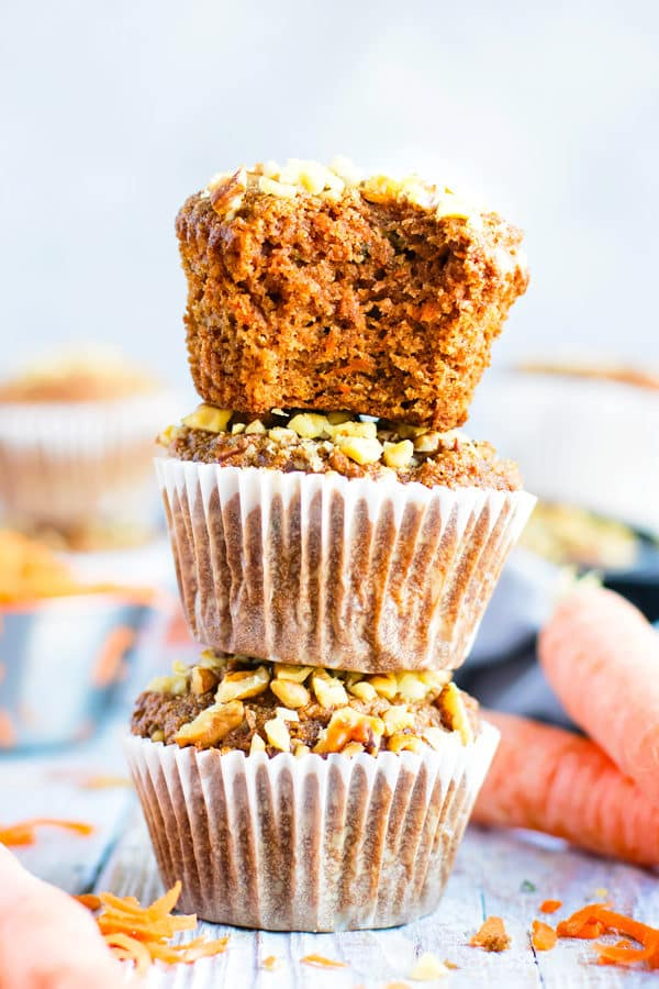 Stacked gluten-free carrot cake muffins recipe on a table.