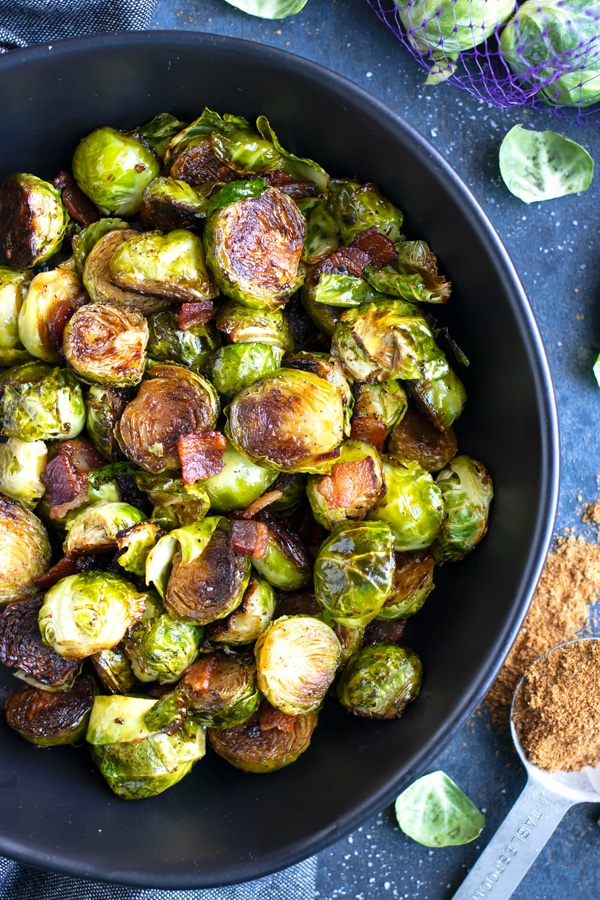 A large serving bowl full of a healthy Brussels sprouts side dish recipe with bacon.