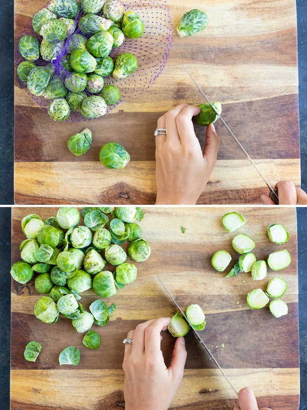 Trimming and cutting the end of a Brussels sprout on a wooden cutting board.