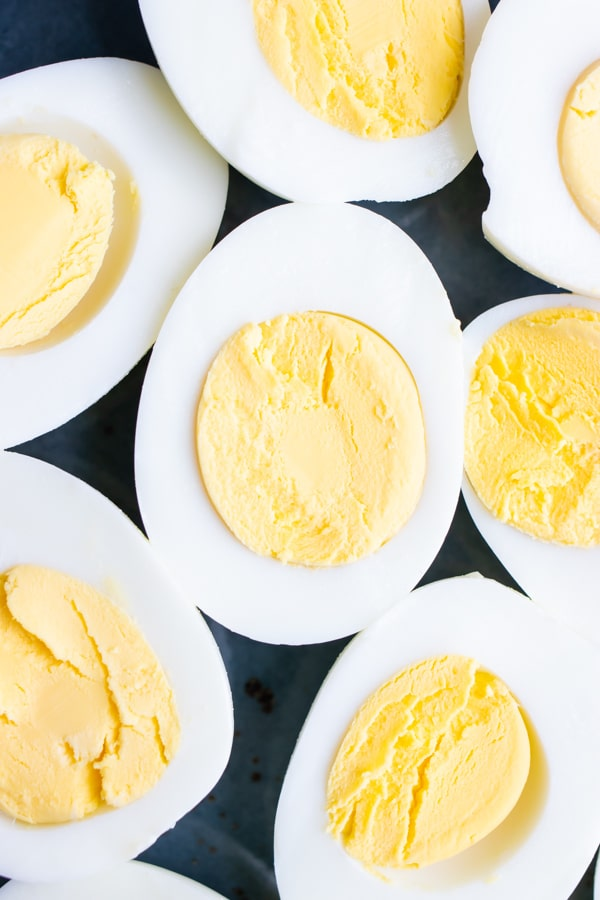 Creamy yellow yolk and firm whites with no green ring on hard-boiled eggs.