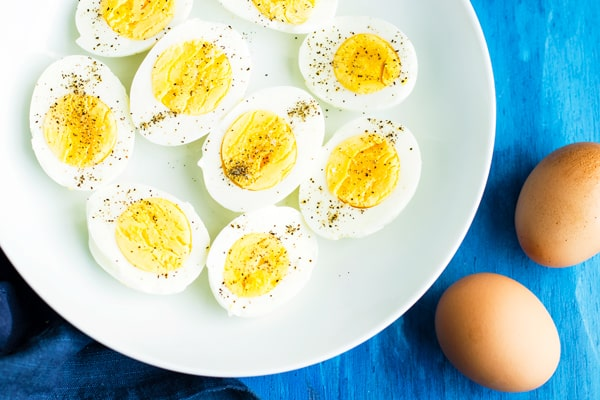 A white plate filled with Instant Pot hard-boiled eggs for lunch.