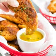Paleo Fried Chicken Tenders with Honey Mustard Sauce | Gluten-free and Paleo fried chicken tenders are coated in a grain-free almond flour crust, pan-fried, and then served with a homemade honey mustard sauce.  These Paleo fried chicken tenders are an adult and kid-approved healthy chicken recipe!