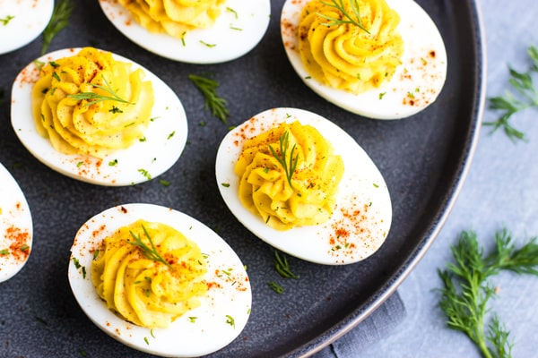 A tray full of a deviled eggs recipe for a delicious appetizer.