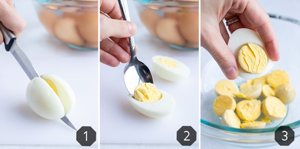 Cutting a hard-boiled egg in half and then scooping out the yolk.