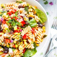 Salsa + Ranch Pasta Salad | This salsa and ranch pasta salad is loaded with Mexican flavors, full of vegetables, and is a great vegetarian and gluten-free pasta salad recipe to make for a crowd!  Make this easy pasta salad for your next potluck in under 30 minutes!