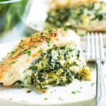 Spinach Artichoke Stuffed Chicken Breasts | Spinach Artichoke Stuffed Chicken Breasts are the perfect combination of your favorite dip and favorite bird, all rolled into one quick and easy chicken breast recipe! These spinach and mozzarella stuffed chicken breasts are gluten-free, low-carb, and Ketogenic diet approved!