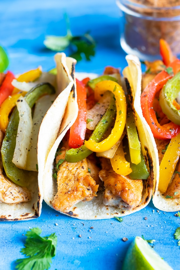 An easy chicken fajitas recipe in a corn tortilla.