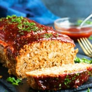 Ground Turkey Paleo Meatloaf | Both meat-lovers and not-so-much-meat-lovers cannot seem to get enough of this Ground Turkey Paleo Meatloaf!  Secretly loaded with veggies, healthy protein, filling fats and makes an excellent low-carb, dairy-free, and gluten-free meatloaf recipe.