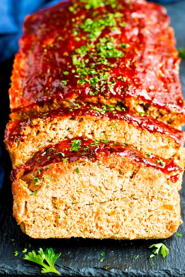 Gluten-free Ground Turkey Meatloaf sliced on a slab.